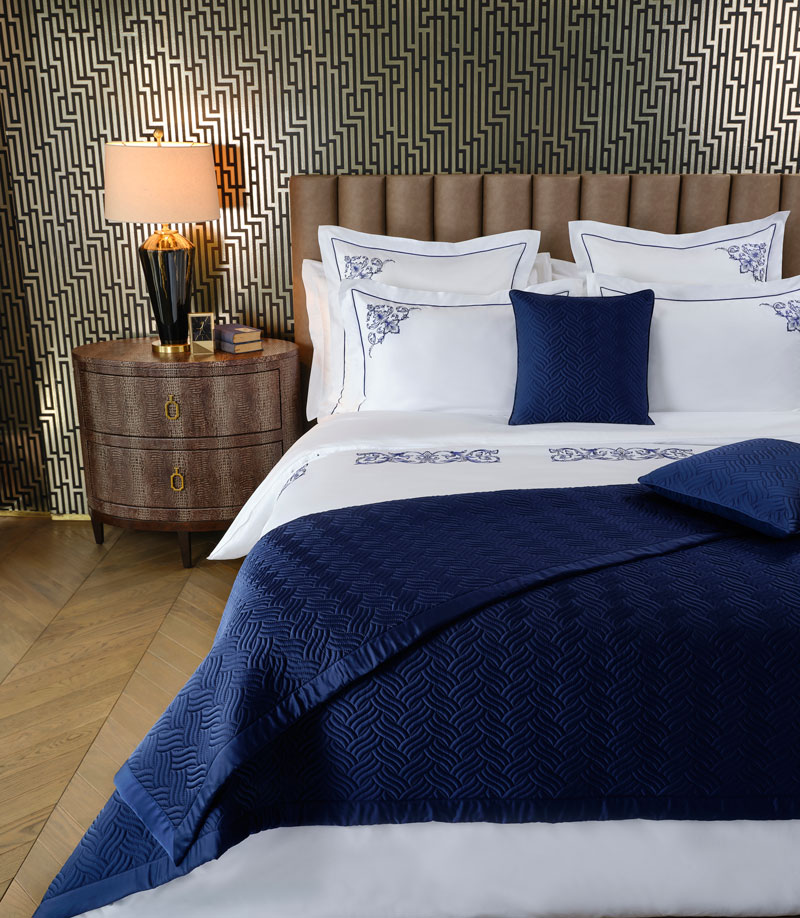 wallpaper of geometric patterns in darker colours to create a Masculine Bedroom