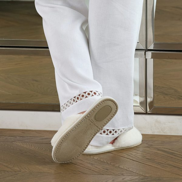 furry whiter slippers back